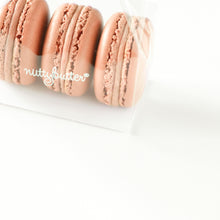 Load image into Gallery viewer, Three of Nuttybutter's hazelnut macarons.