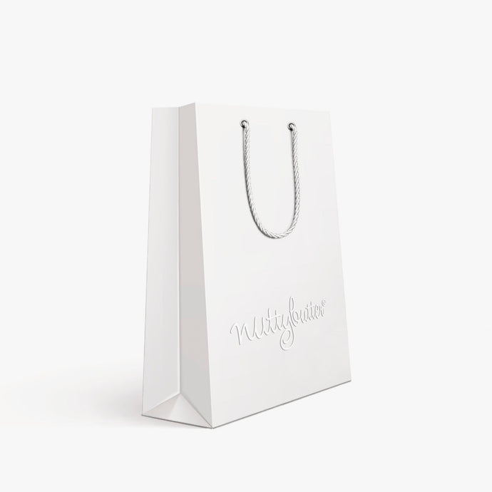 Nuttybutter's white gift bag. Beautiful, elegant branding for your macaron gift box.