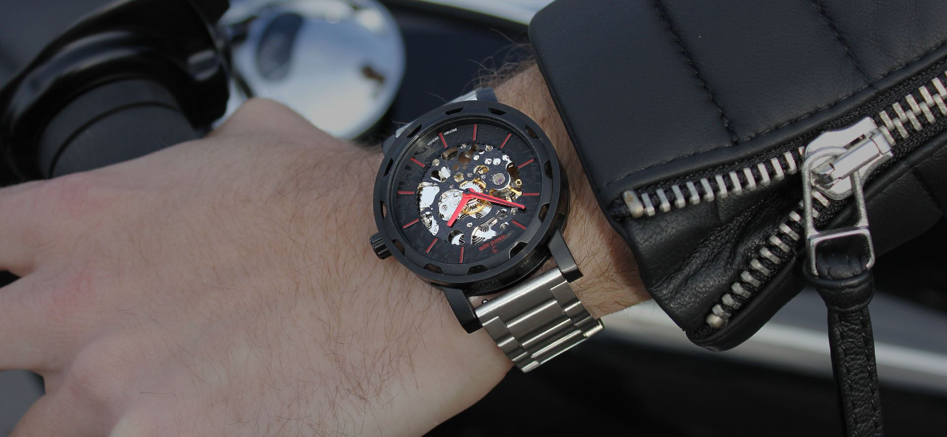 Black skeleton watch with a silver strap in a lifestyle image