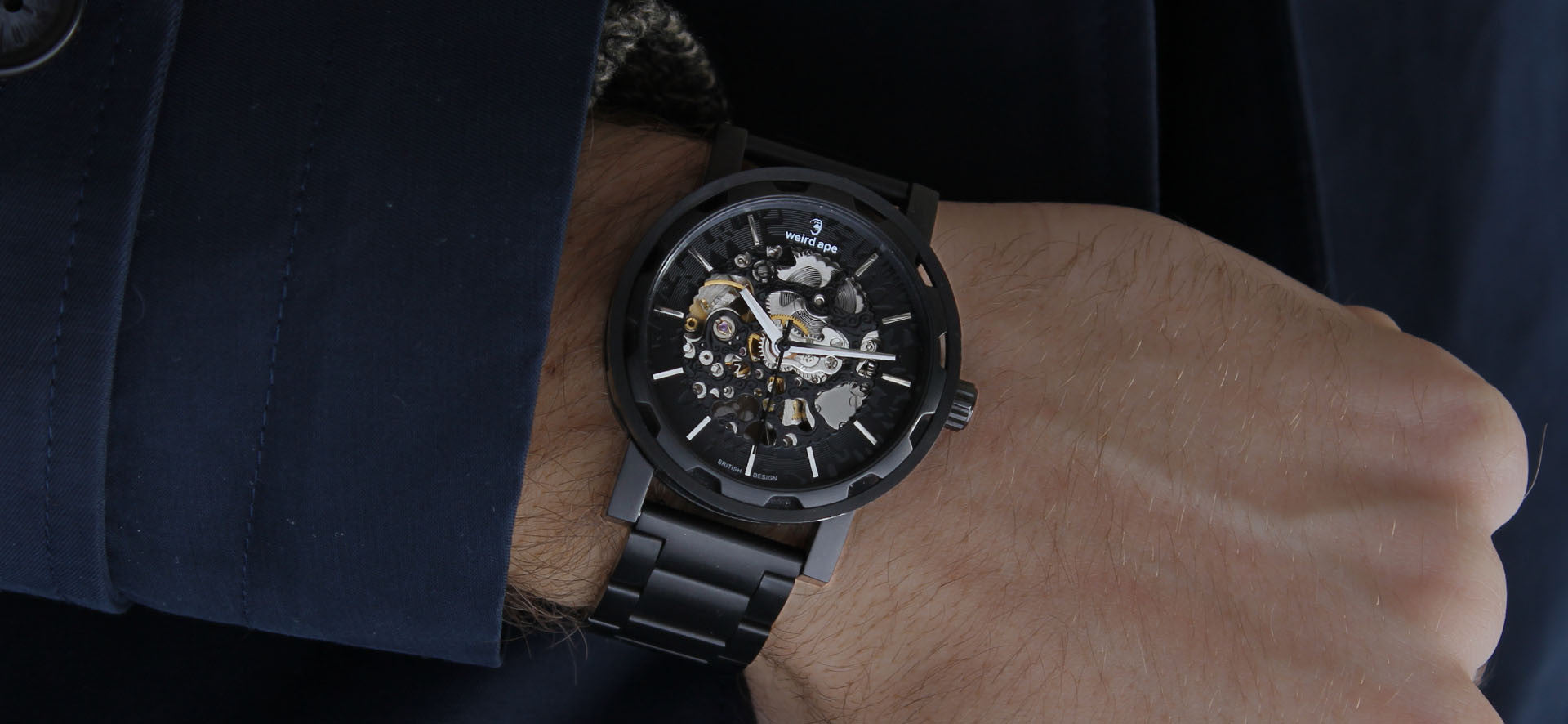 Black skeleton watch with a black strap in a lifestyle image