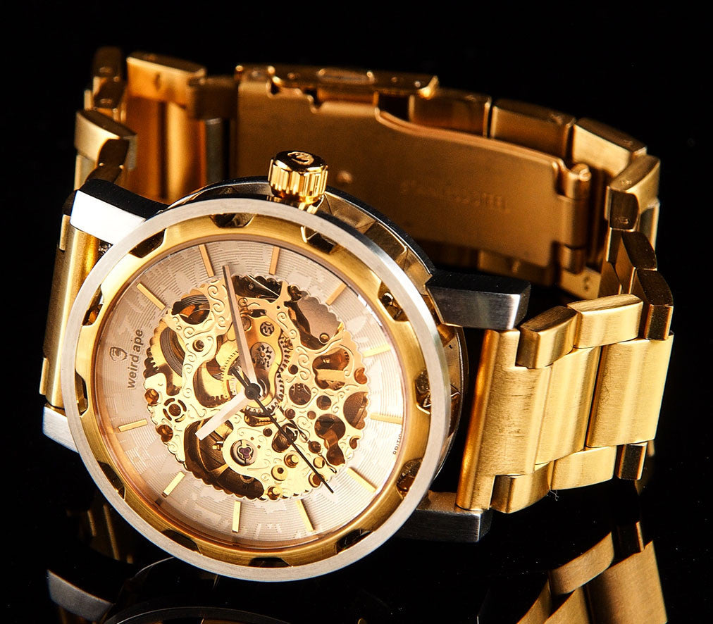 Gold skeleton watch with a gold strap in a lifestyle image