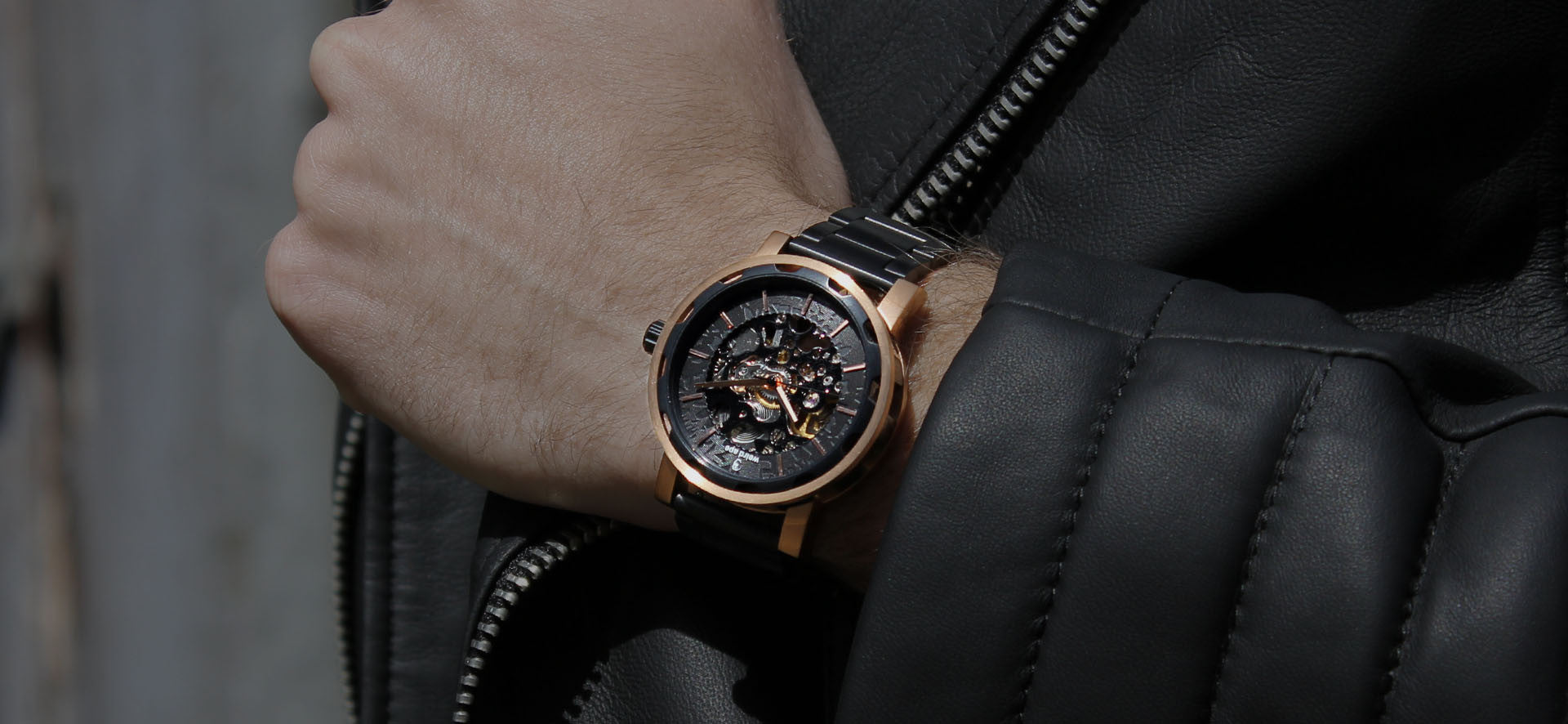 Rose gold skeleton watch with strap in a lifestyle image