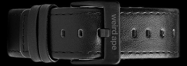 A black leather strap with a black buckle for a mechanical watch.
