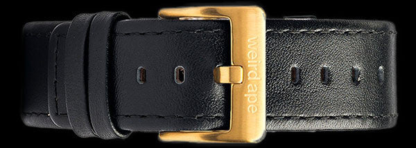A black leather strap with gold buckle for a mechanical watch.
