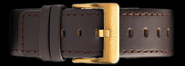 A brown leather strap with gold buckle for a mechanical watch.