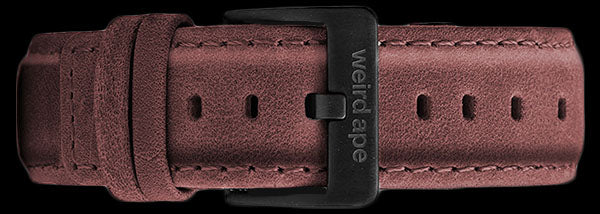 A burgundy suede leather strap with a black buckle for a mechanical watch.