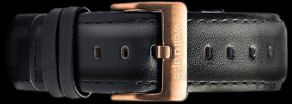 A black leather strap with rose gold buckle for a mechanical watch.