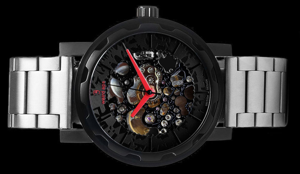 Black mechanical watch with silver strap on its side.