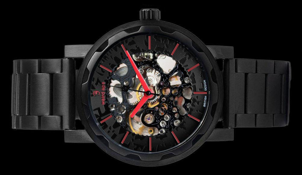 Black mechanical watch with red hands and metal strap on its side.