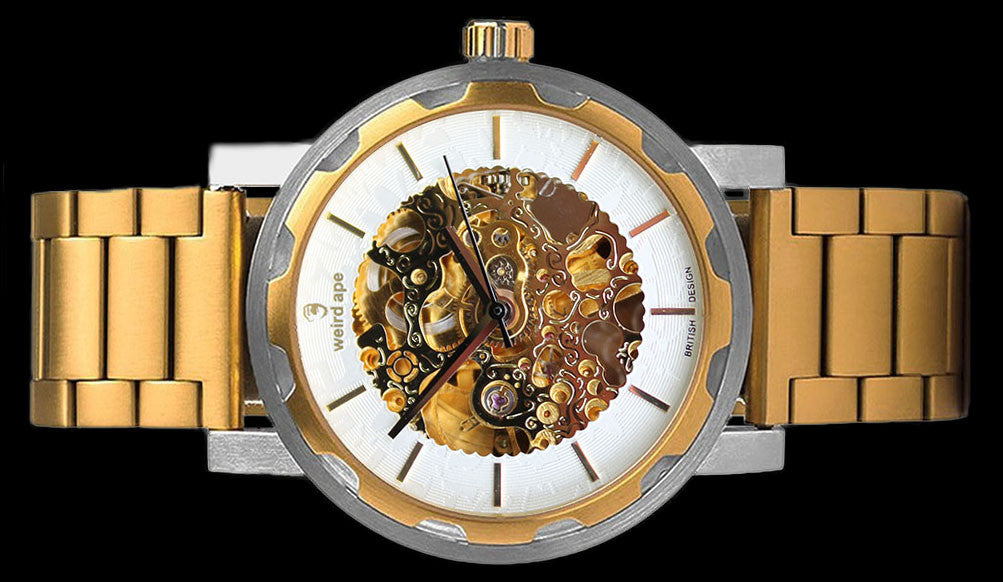 Gold mechanical watch with gold strap on its side.