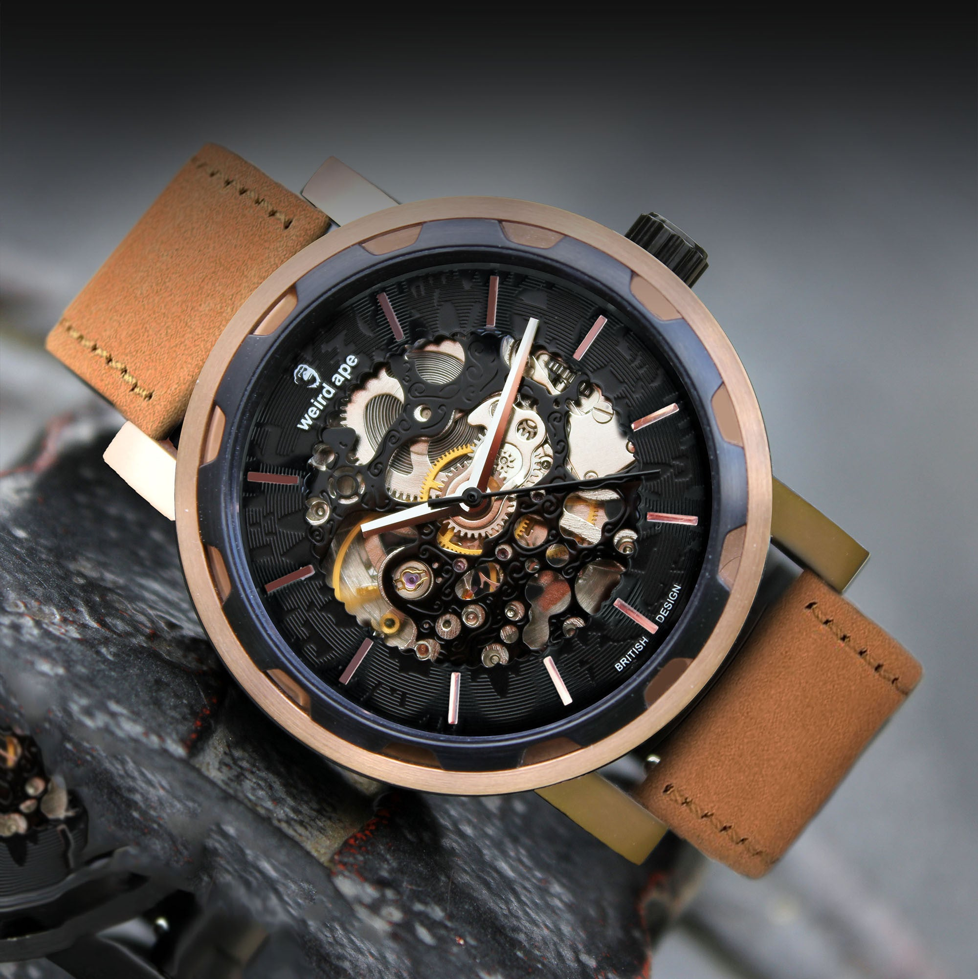 A picture of a rose gold mechanical watch with a leather tan strap.