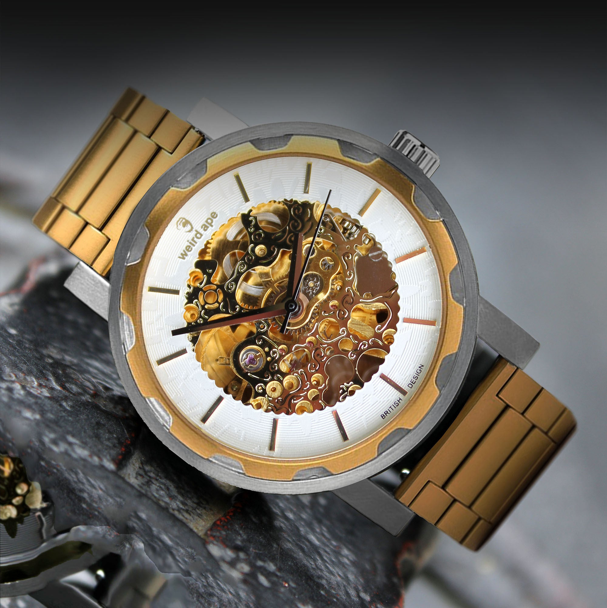 A picture of a gold mechanical watch with a gold steel strap.