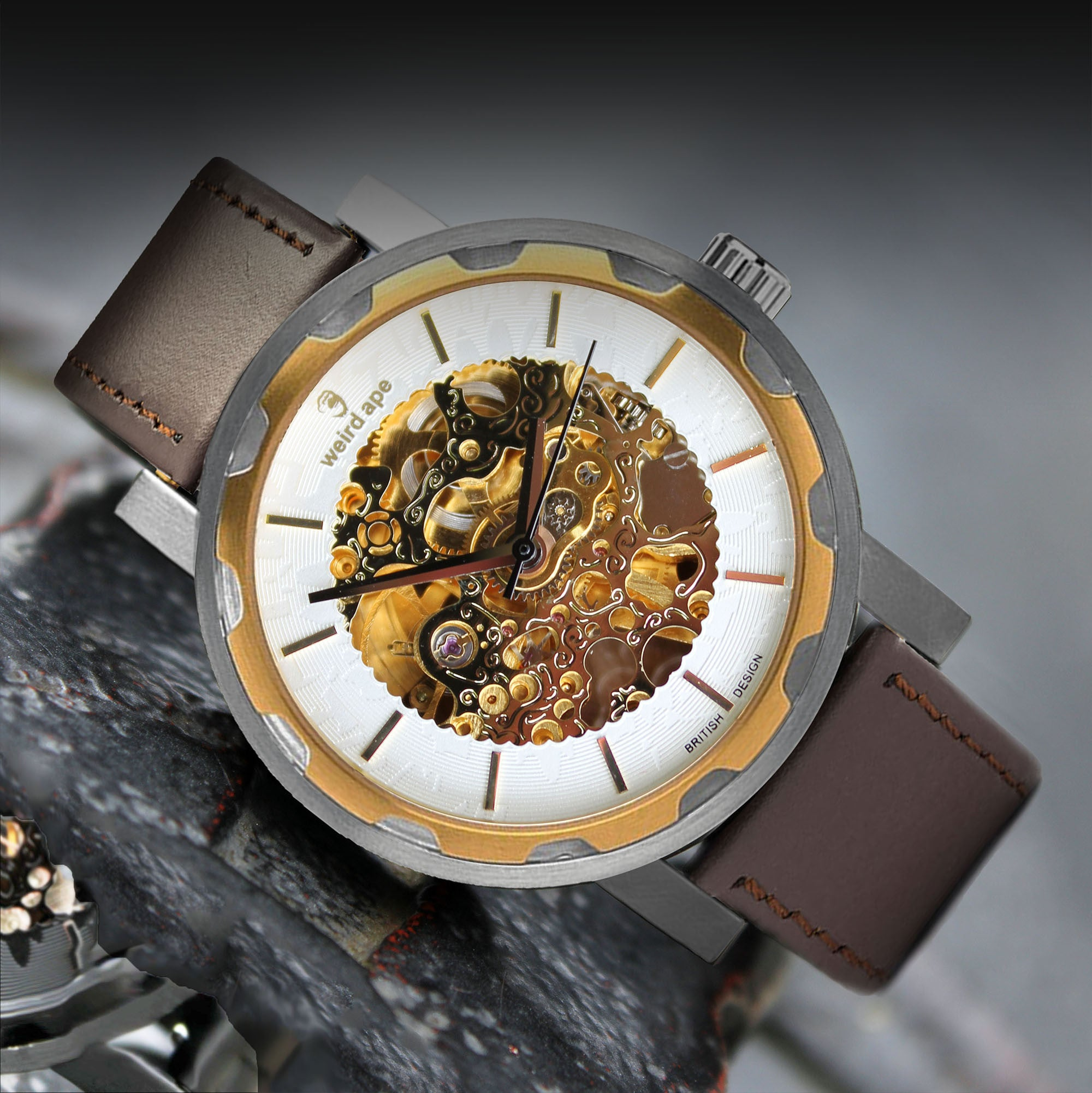 A picture of a gold mechanical watch with a brown leather strap.