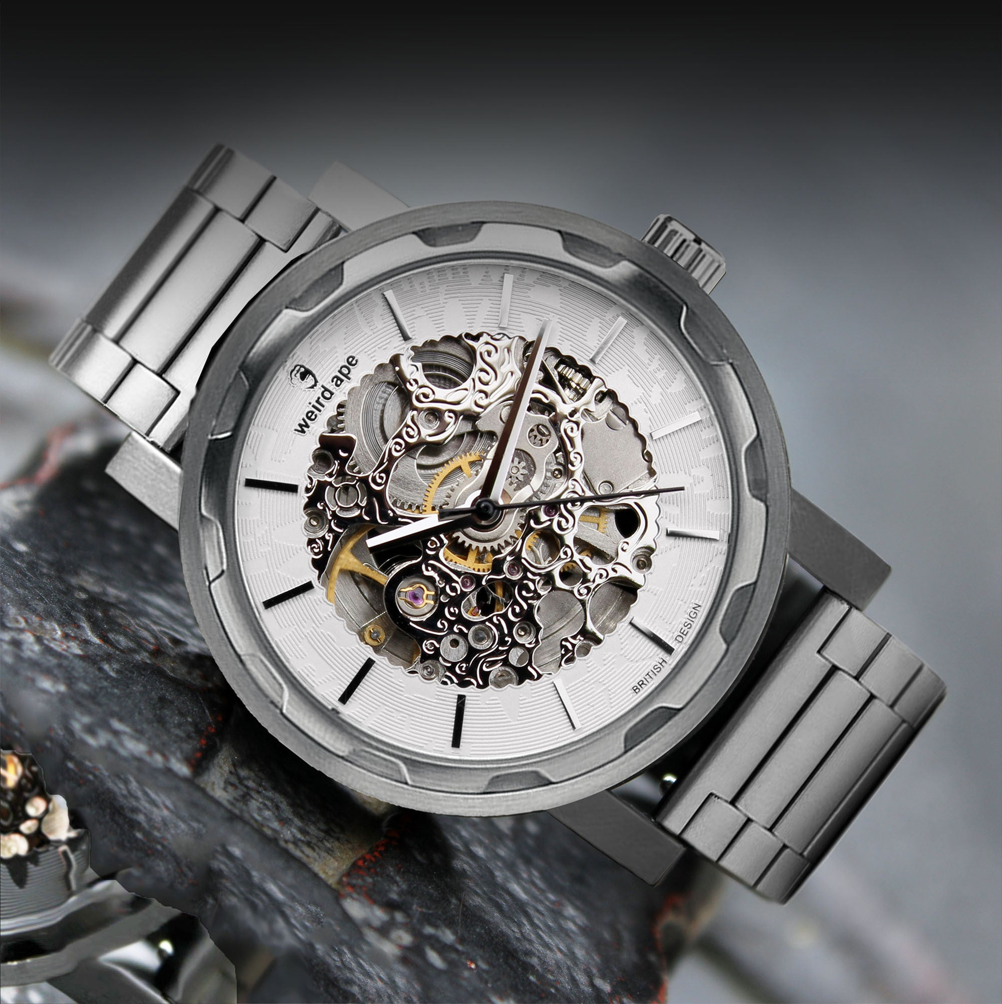 A picture of a silver mechanical watch with a silver steel strap.