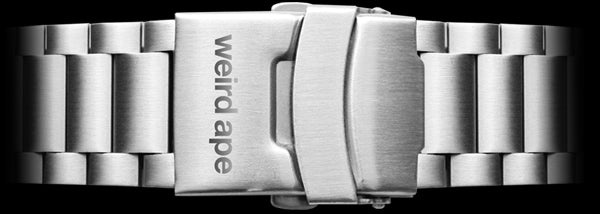 A silver metal strap for a mechanical watch.