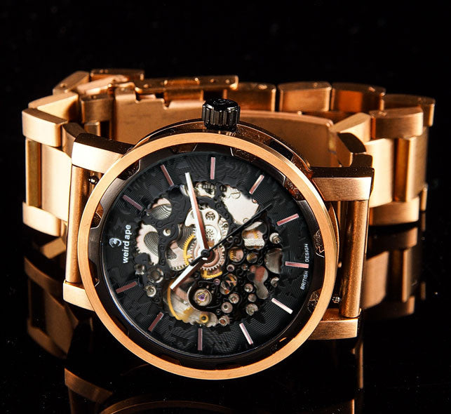Rose gold skeleton watch on black background.