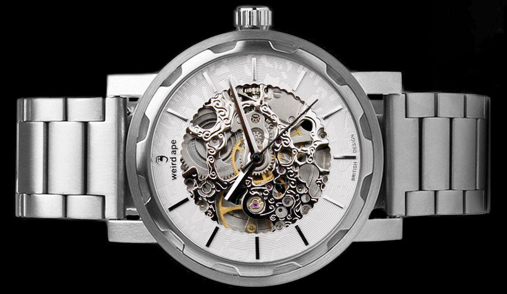 Silver mechanical watch with silver strap on its side.