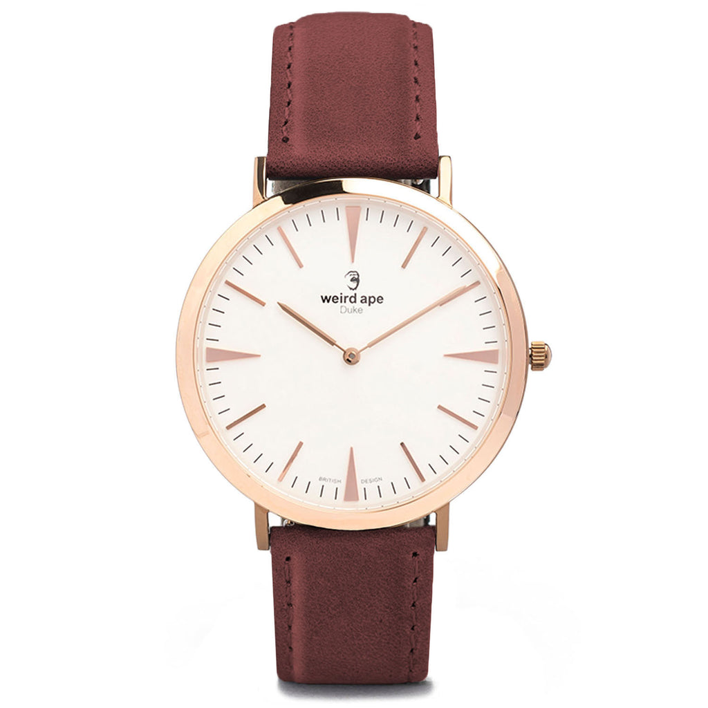 A rose gold minimal watch with a burgundy strap called the Duke.