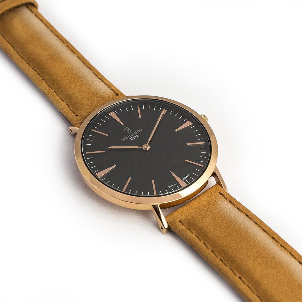 The side of a Rose gold minimal analog watch from our Rose gold minimal watches.