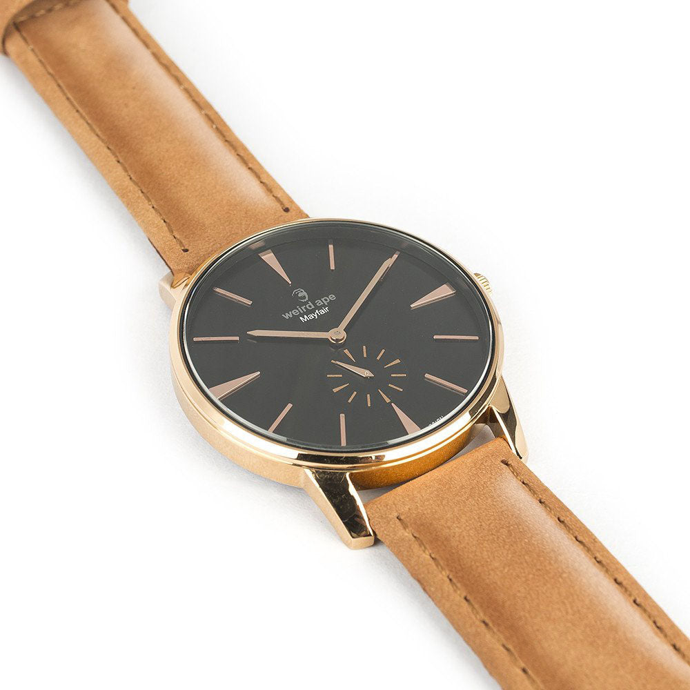 The side of a Rose gold minimal analog watch design from our Rose gold minimalist watches.