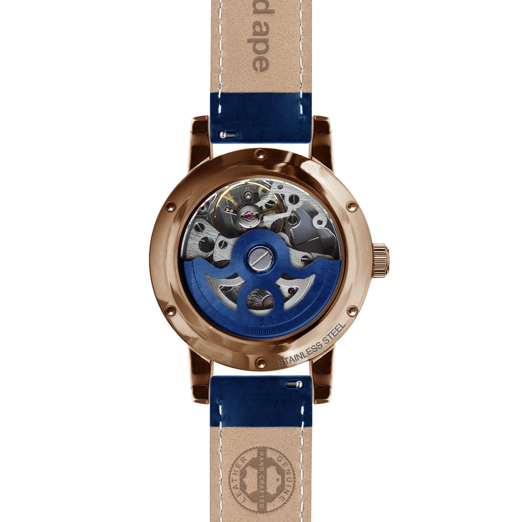 Weird Ape Rosalind - Women's Rose gold skeleton watch with a Indigo Blue strap