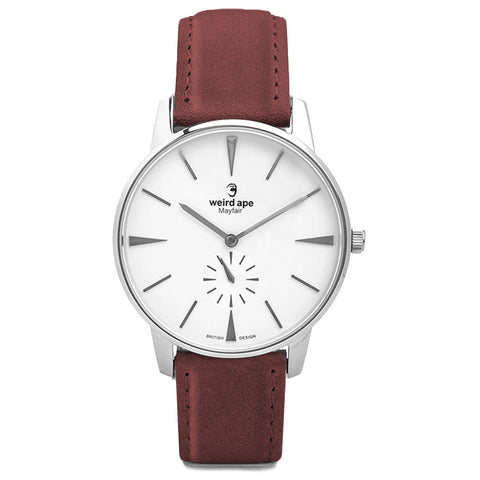 A white minimal watch with a burgundy strap.