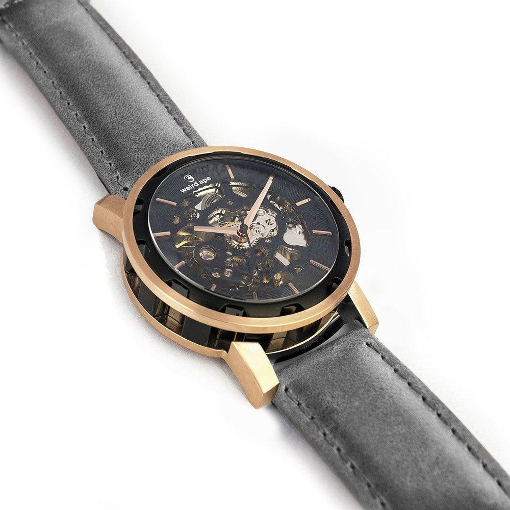 Side angle of rose gold mechanical skeleton watch