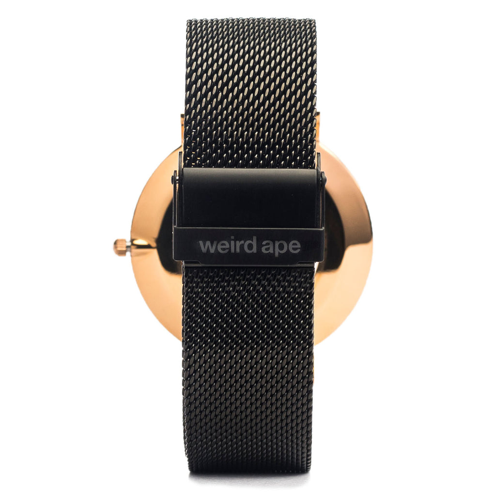 A photo of a Rose gold minimal analog watch from our Rose gold minimalist mens watches.
