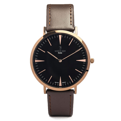A photo of a Rose gold minimal analog watch from our Rose gold simple mens watches.