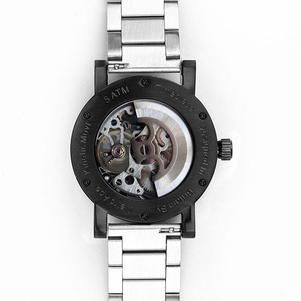 Reverse of black and silver skeleton watch.
