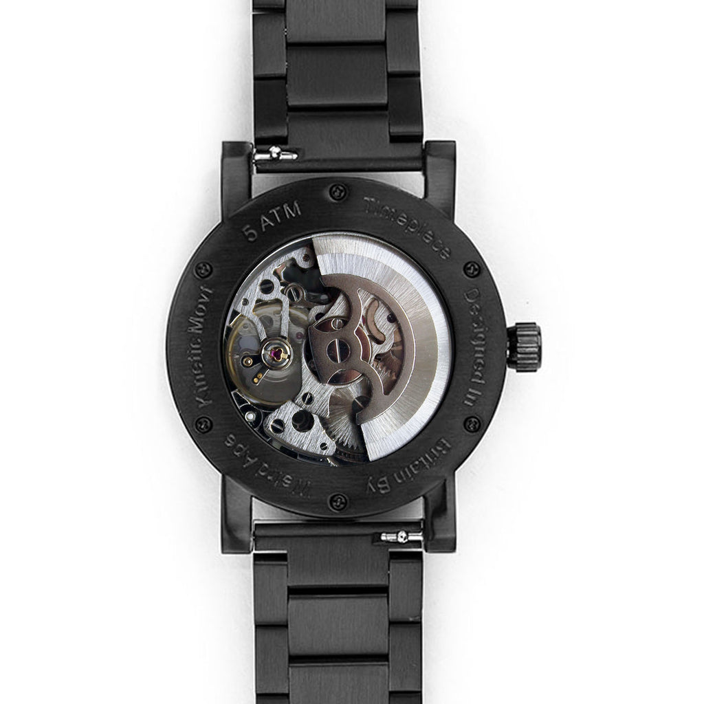Reverse of black skeleton watch
