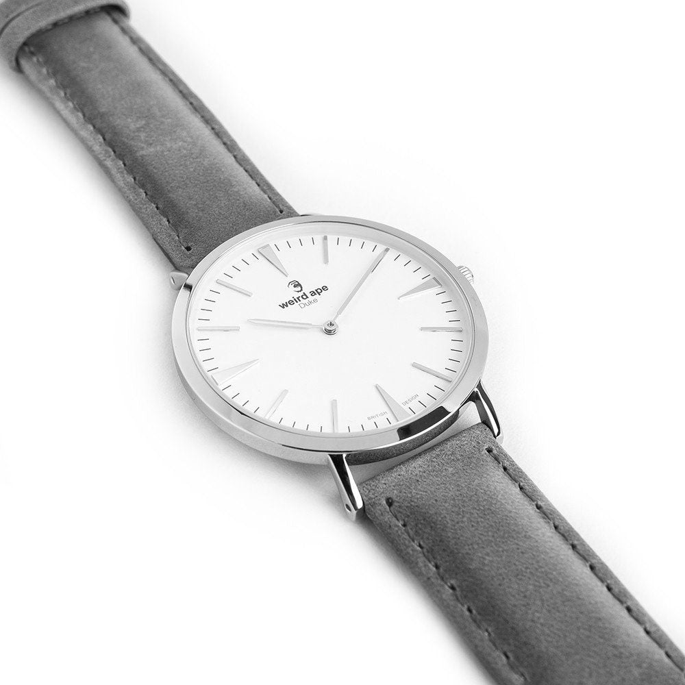 Side profile of a silver minimal watch grey a burgundy strap called the Duke.
