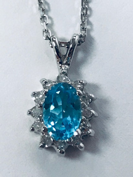 Oval Blue Topaz Necklace in 14k White Gold
