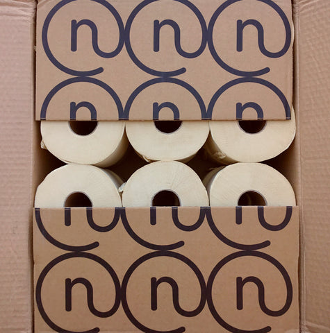 Naturolly unbleached bamboo toilet paper in recycled cardboard box printed with eco friendly soybean ink sealed with paper tape showing logos