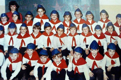 """If you were born in 1982 or earlier, chances are that in the first grade of primary school, on the day of the former Yugoslavia, wearing a pioneer uniform - a blue """"titovka"""" hat with a red five-pointed star, a white shirt with a red scarf and blue pants, you gave a pioneer oath:  Today, when I become a pioneer, I give the honorable pioneer word - that I will study and work diligently, respect parents and the elderly, and be a faithful and sincere companion, who holds a given word."""