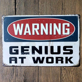 Genius at Work Sign - Metal Tin Poster