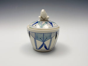 Lidded jar with sculpted bird