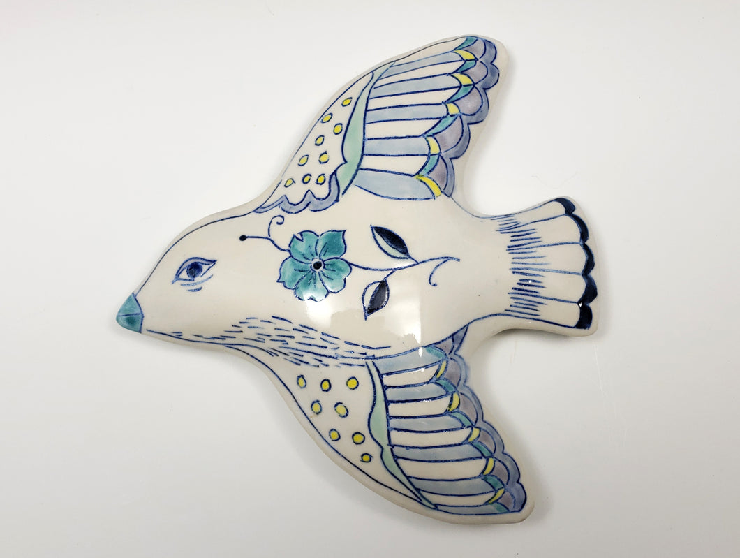 Wall hanging flying bird sculpture