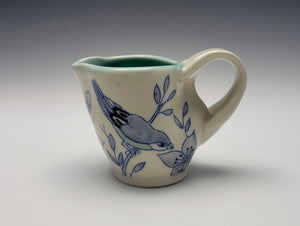 Creamer with dogwood flowers and birds