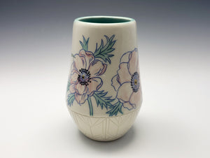Vase with pink anemones and hummingbird