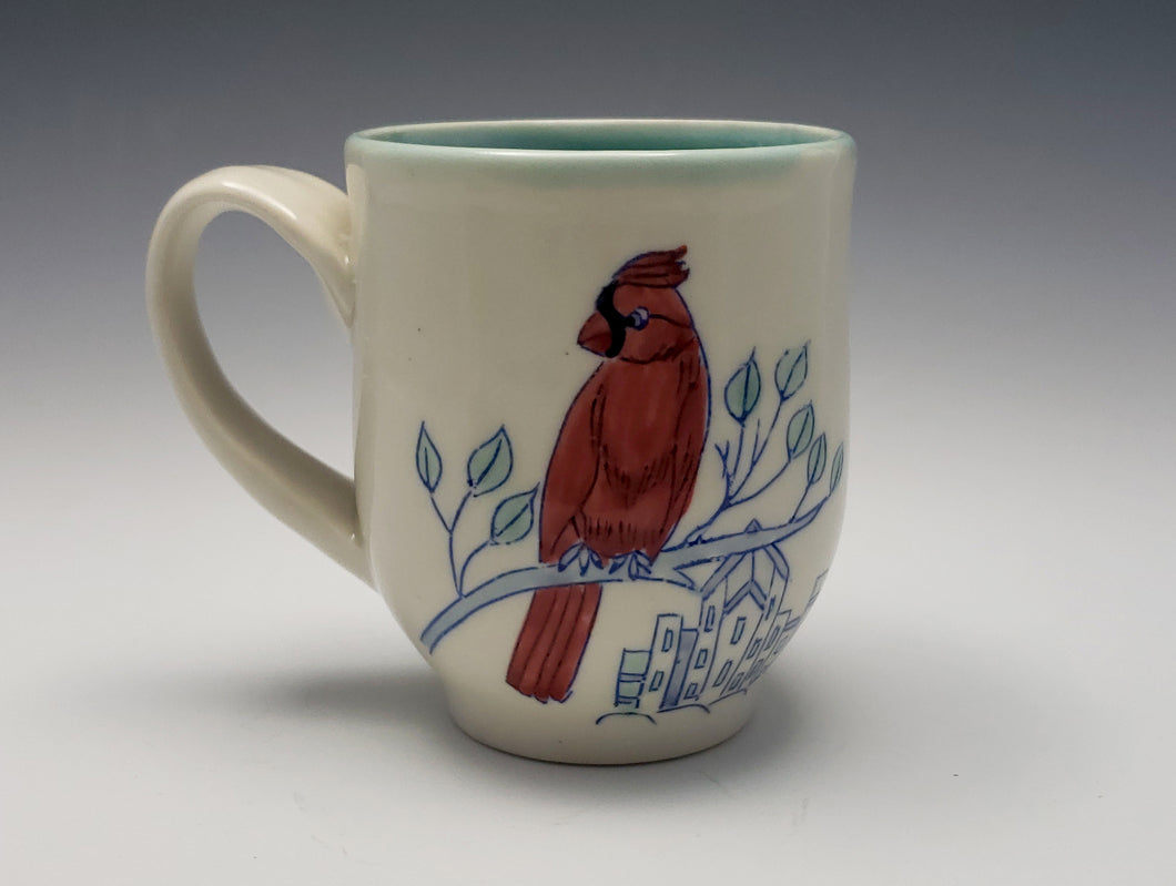 Mug with cardinal and city buildings