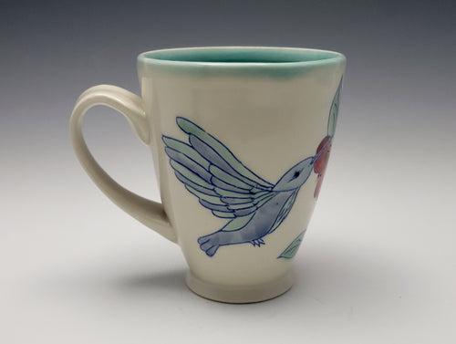 Mug with hummingbirds and hibiscus flowers