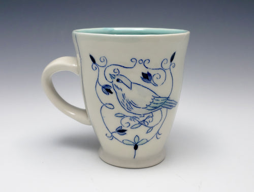 Mug with a bird and floral ornament – made to order