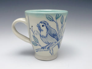 Mug with a scruffy bird