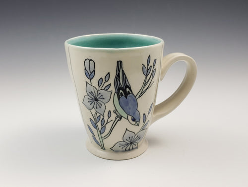 Mug with a bird and dogwood blossoms – made to order