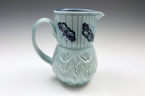 Pitcher with moths and flowers