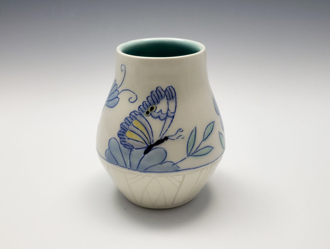 Vase with butterflies and blue flowers