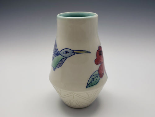 Vase with hummingbird and red hibiscus
