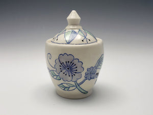 Lidded sugar jar with flowers