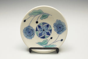 Tiny plate with blue flowers